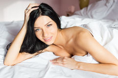 Beautiful happy smiling young woman in bed Royalty Free Stock Photos