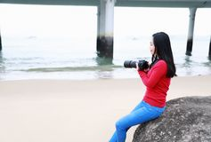Woman Photograph woman learning photography in Seaside beach stock photo