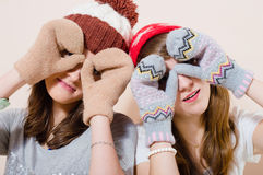 Beautiful happy smiling young women in knitting Stock Photo