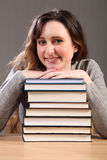 Beautiful happy student sitting with study books Stock Photo