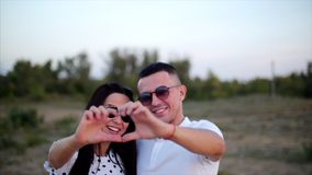 Beautiful Happy Stylish Joyful Young European Cute Couple in the Arms of Each other, Makes out of the Hands of a stock video footage