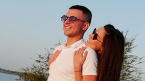 Beautiful Happy Stylish Joyful Young European Cute Couple in Black Glasses with Beautiful Smiles in Each other`s Arms. stock footage
