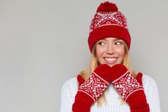 Beautiful happy surprised woman looking sideways in excitement. Excited christmas girl wearing knitted warm hat and mittens Stock Images