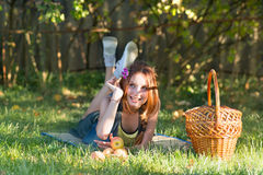 Beautiful happy teen girl with a basket in the garden Stock Photos
