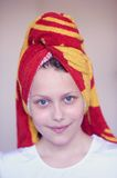 Beautiful happy teen girl with towel on her head Stock Image