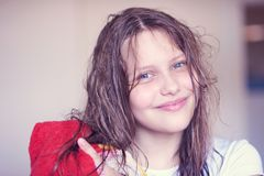 Beautiful happy teen girl with wet hair Stock Photo