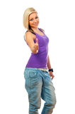 Beautiful happy teenage girl showing thumbs up Stock Image