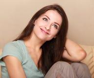 Beautiful happy thinking girl sitting Royalty Free Stock Image