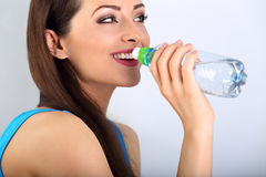 Beautiful happy toothy smiling makeup woman drinking water from Stock Images