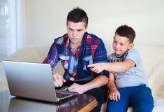 Beautiful happy two brothers buying online Royalty Free Stock Image