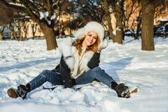 Beautiful happy winter woman in fur clothes having fun outdoor stock photos