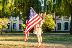 Beautiful happy woman with American flag celebrating independence day Stock Photo