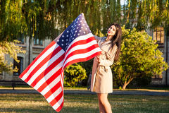 Beautiful happy woman with American flag celebrating independence day Royalty Free Stock Images