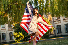 Beautiful happy woman with American flag celebrating independence day Stock Photos