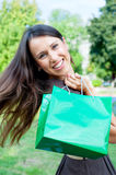 Beautiful happy woman with bag stock photography