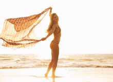 Beautiful happy woman on beach at sunset Royalty Free Stock Photo