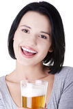 Beautiful happy woman with beer Royalty Free Stock Image