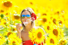 Beautiful happy woman blowing soap bubbles Stock Photography