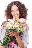 Beautiful happy woman with bouquet of flowers Stock Image