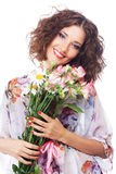 Beautiful happy woman with bouquet of flowers Stock Photos