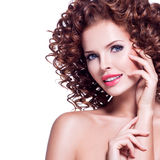 Beautiful happy woman with brunette curly hair. Royalty Free Stock Photo