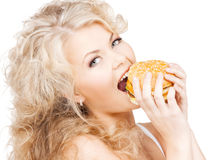 Beautiful happy woman with burger Stock Photos