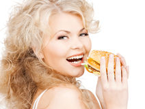 Beautiful happy woman with burger Royalty Free Stock Photo