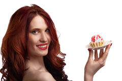 Beautiful happy woman with cake on the plate Stock Image