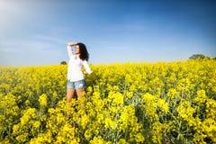 Beautiful happy woman in canola field Royalty Free Stock Photo