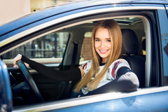 Beautiful happy woman in the car looking in camera Stock Photos