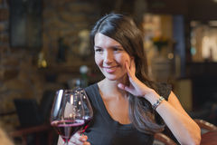 Beautiful happy woman celebrating with red wine Royalty Free Stock Photo
