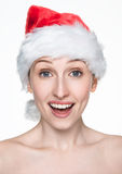 Beautiful happy woman in christmas santa hat Royalty Free Stock Photography