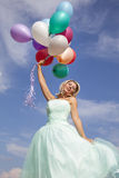 Beautiful, happy woman dancing with balloons Royalty Free Stock Photography