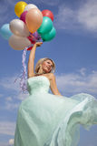 Beautiful, happy woman dancing with balloons Royalty Free Stock Photos