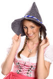 Beautiful happy woman in a dirndl and hat Royalty Free Stock Photo