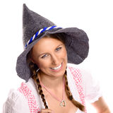 Beautiful happy woman in a dirndl and hat Royalty Free Stock Images