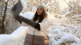Beautiful happy woman doing self on the tablet stock video footage