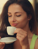 Beautiful happy woman drinking coffee with closed eye Stock Photography