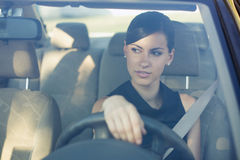 Beautiful happy woman driving her car Royalty Free Stock Images