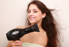 Beautiful happy woman drying brown hair Stock Images