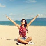 Beautiful happy woman enjoying freedom on the beach Royalty Free Stock Photo