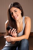 Beautiful happy woman enjoying smart phone music Stock Photo