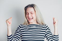 Beautiful happy woman excited expressing winning gesture. Successful and celebrating victory, triumphant on white background. stock photos