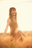 Beautiful happy woman in field at sunset. Beautiful happy woman in golden field at sunset, Carefree healthy lifestyle, Vibrant color, Backlit warm tones royalty free stock photography