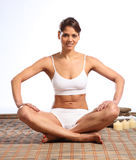 Beautiful happy woman with fit body sitting Royalty Free Stock Photos