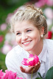 Beautiful happy woman in flower garden Royalty Free Stock Photos