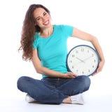 Beautiful happy woman fun time on her side clock Stock Photos