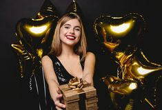 Beautiful happy woman with gift box at celebration party. Birthday or New Year eve celebrating concept. royalty free stock photos