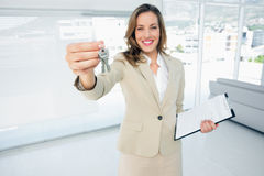 Beautiful happy woman handing over house keys Stock Images