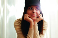 Beautiful happy woman in hat looking away Stock Photo